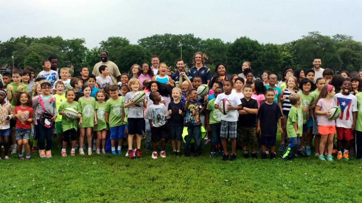 Smith Park Campers get Rugby lesson.