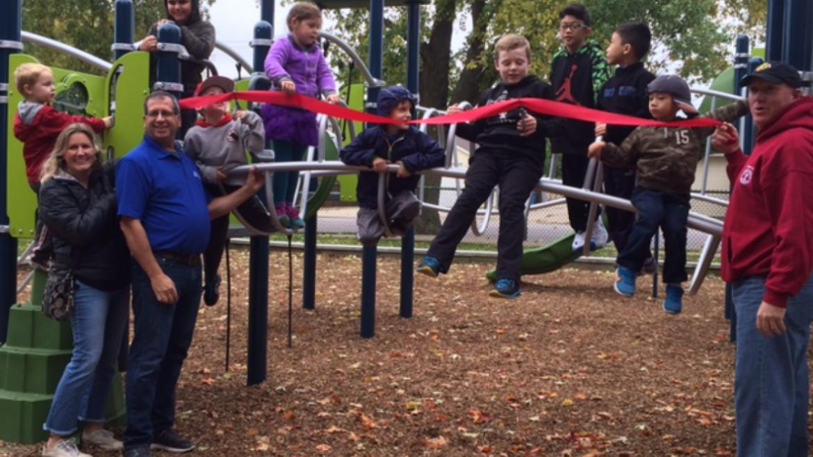 The ribbon is cut at Austin Foster Playground.