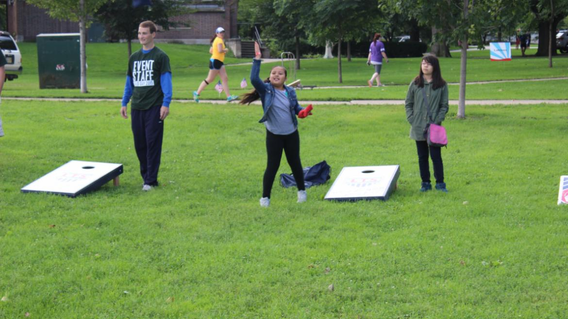 Veterans Field Day 2015- kids playing bags