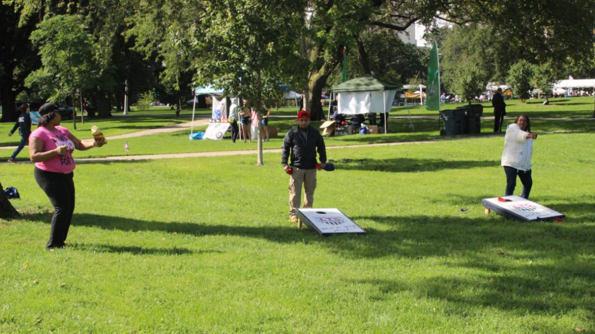 Veterans Field Day 2015- dancing while playing bags