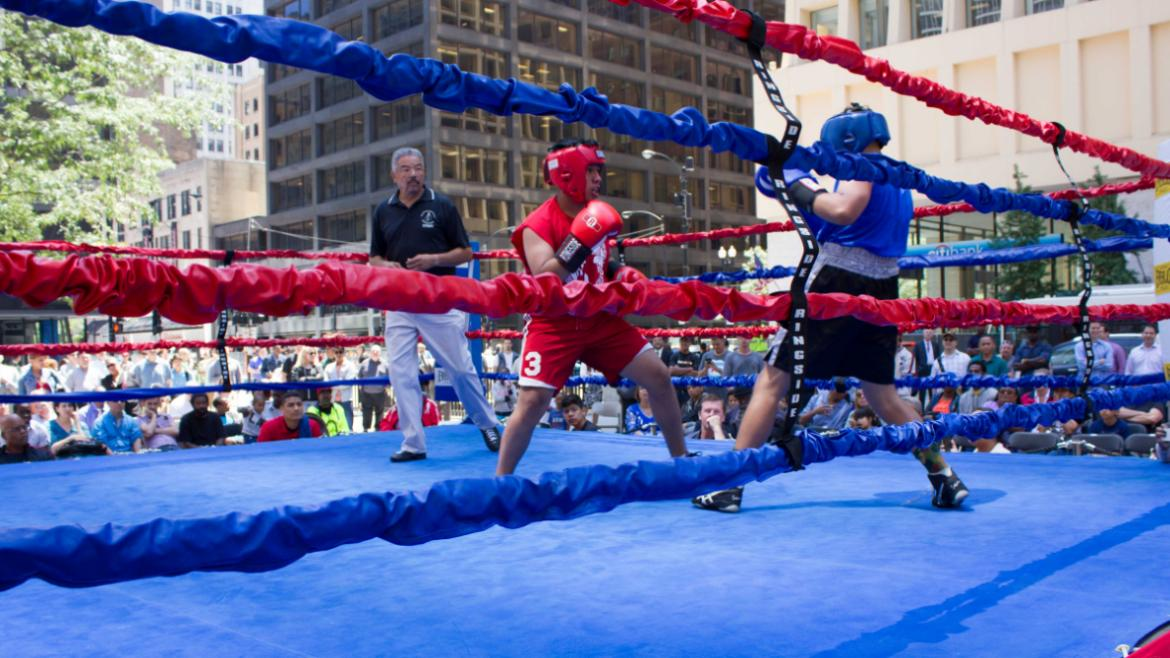 Youth boxers in the ring at Daley Plaza