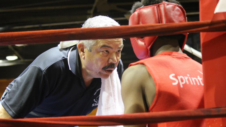 Boxer receives coaching.