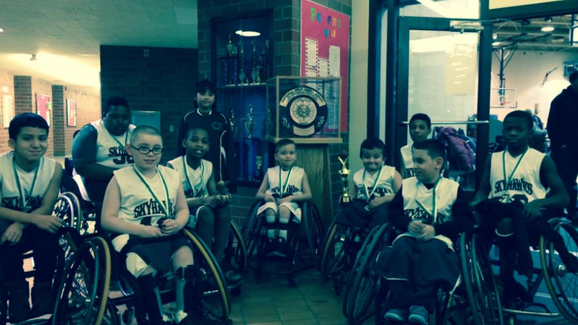 Basketball Bonanza wheelchair basketball team with the Gold Medal.