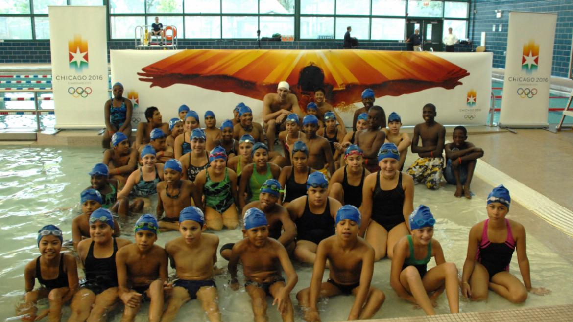 Chicago Park District swimming program participants take a photo they'll always remember with Michae