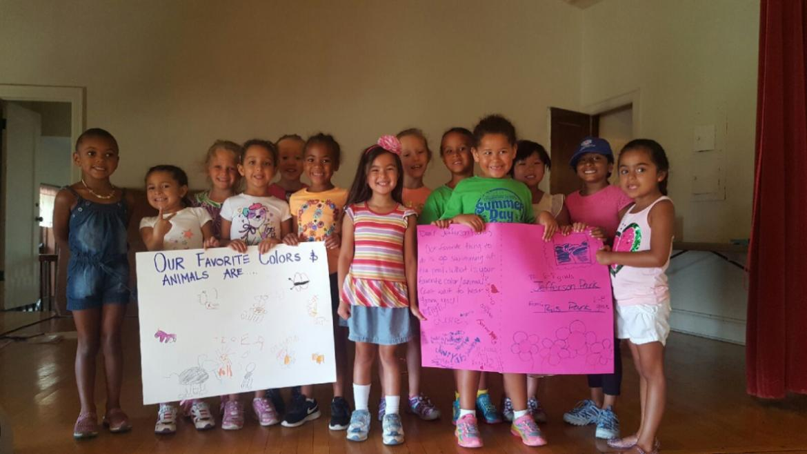 The girls at Jefferson Park are excited to receive oversized post cards from their pen pals.