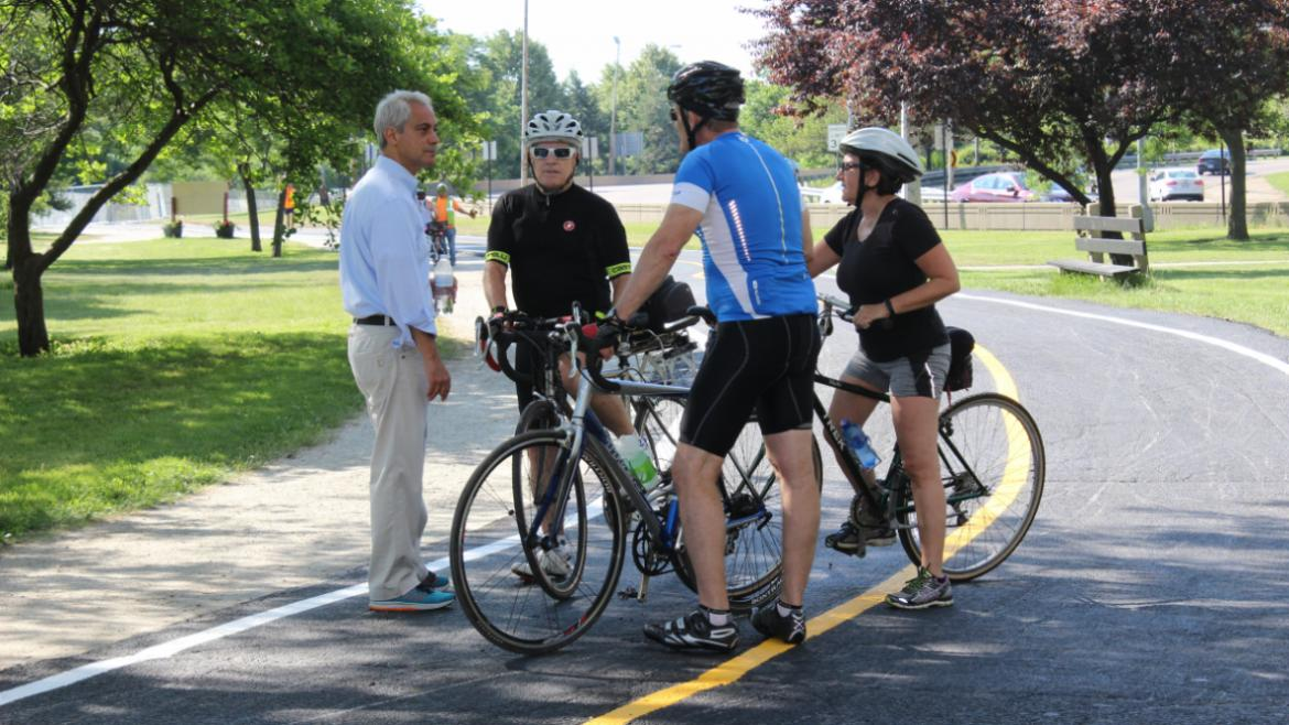 Mayor chats with cyclist about the newly opened Lakefront trail separation.