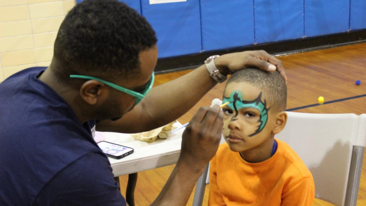 Face painting at Loyola Park.