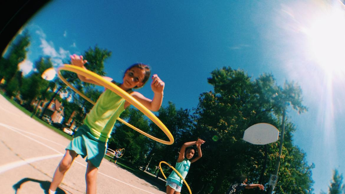 Girl hula hooping at Mayfair Park