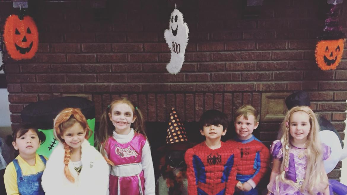 Our kiddie college kiddos pose for a Halloween group photo op.