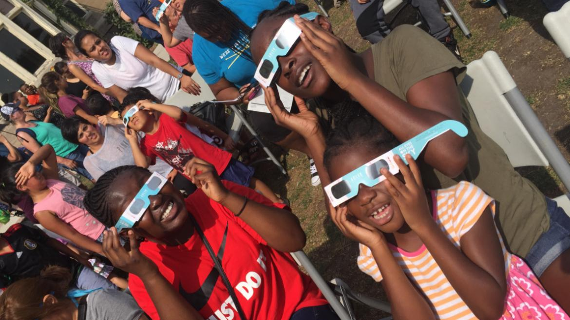 Park visitors of all ages enjoyed watching the eclipse at Berger Park.