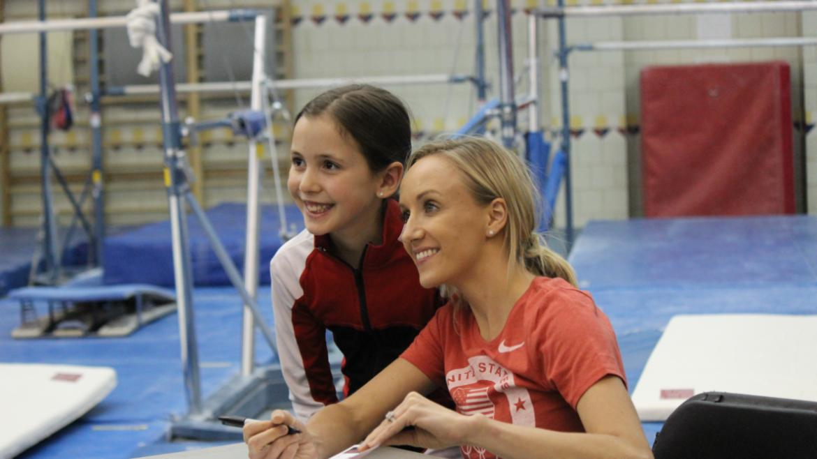 Nastia Liukin posing for photos.