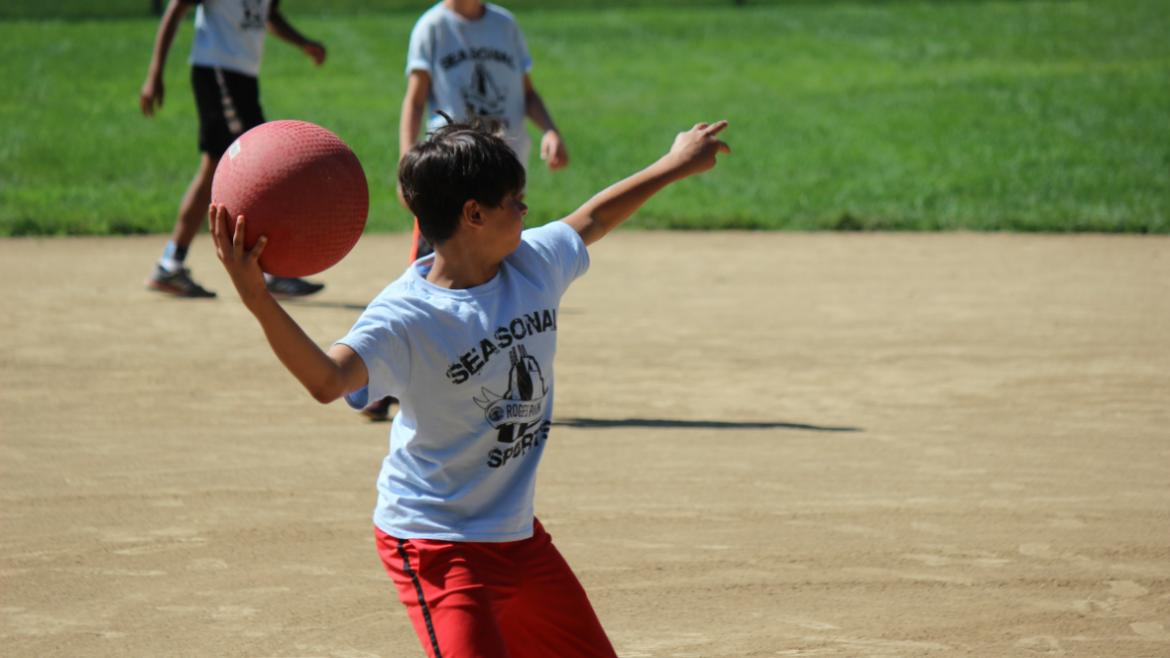 Youth playing kickball.
