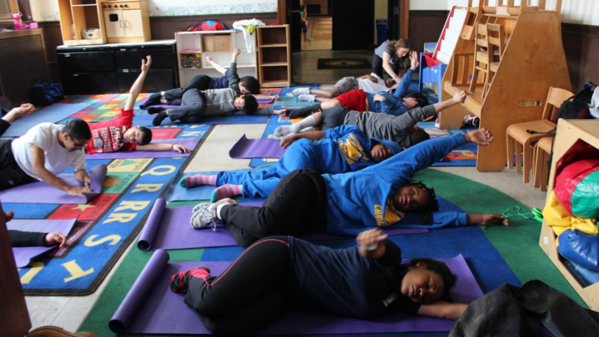 Some teens engaged in a yoga class