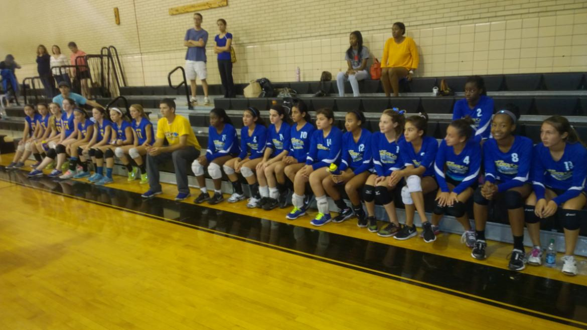 Volleyball players on the bench before the game.