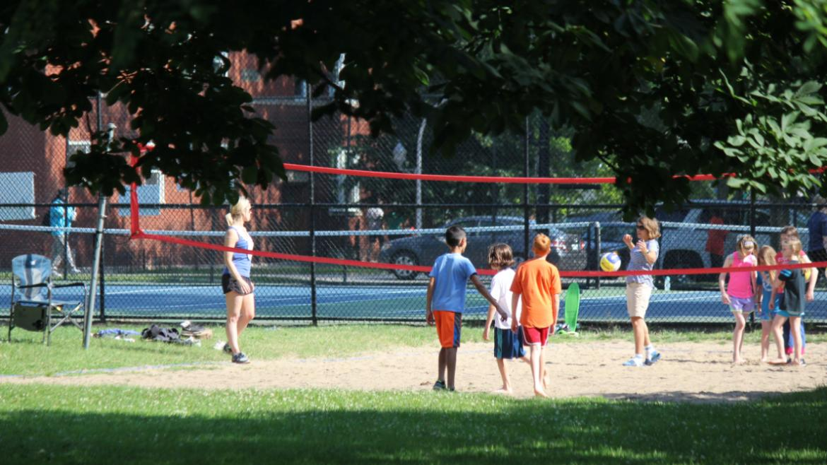 Welles Park campers playing sand volleyball.