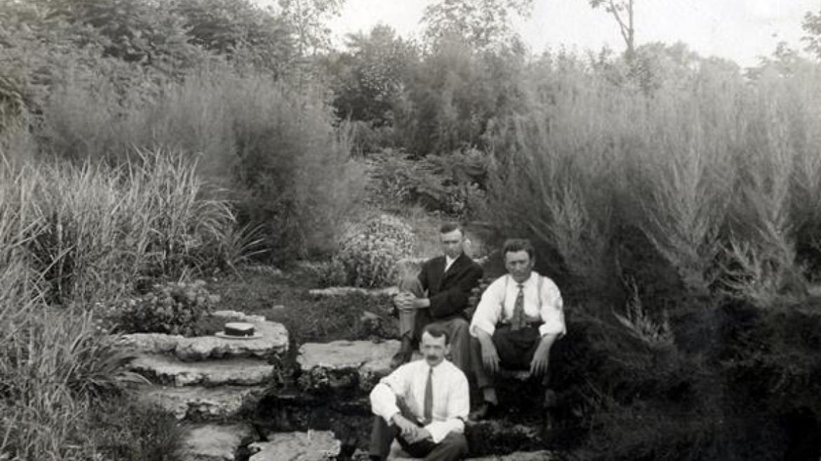Men sitting on original stonework in Humboldt Park, ca. 1910