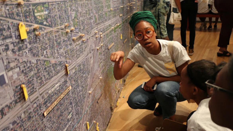 Teaching Artist Zakkiyyah Najeebah with TRACErs @ Tonika Johnson's Folded Map exhibition at the Loyola University Museum of Art