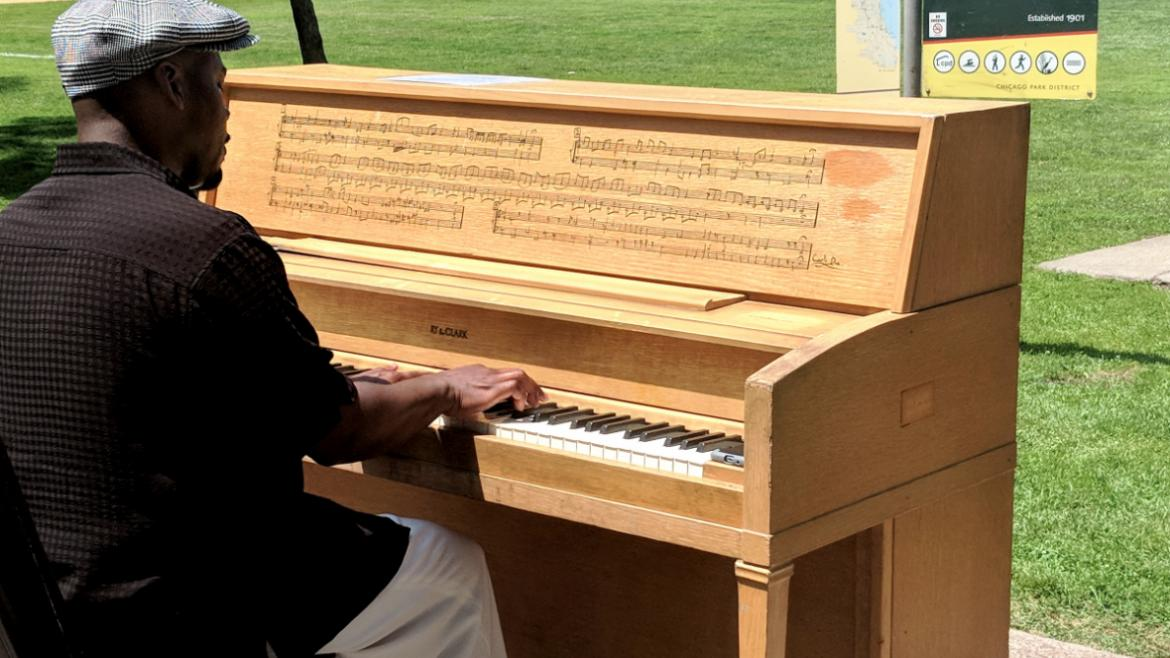 Pianist Reginald R. Robinson tickles the ivories of one of the five Pianos in the Parks.