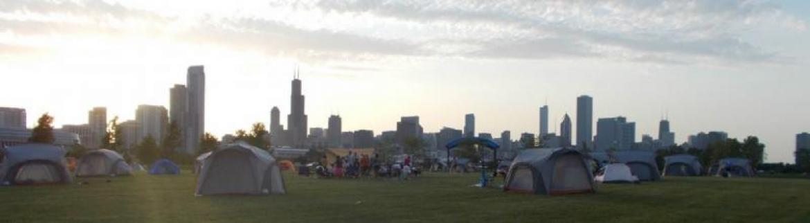 A number of tents are lined up for a night of camping at Northerly Island