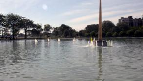 A model yacht club launched boats in the basin during the dedication ceremony for Ecstasy