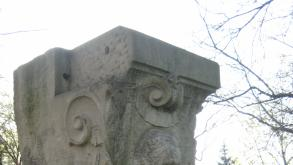 The plaque on the base of the keystone acknowledges that its donor, Julius H. Huber.