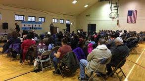 The community gathered to hear presenters discuss root causes of violence in our communities.
