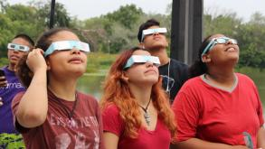Teens viewed the eclipse from Humboldt's boathouse with glasses from Adler