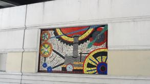 Some of the mosaic panels illustrate themes related to the nearby Museum of Science and Industry.