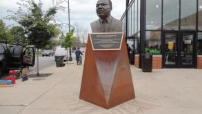 The bronze portrait bust of Dr. Martin Luther King Jr. sits on a base made of Corten Steel.