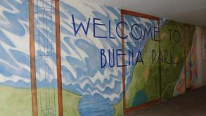Artist Jeffrey Littleton combined imagery from the park and the neighborhood for this gateway mural,