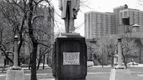 View of Carter Harrison Monument with bronze plaque on its base and the original adjacent lighting