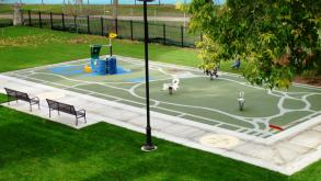A map of Washingon Park serves as the soft surface beneath the playground equipment, 2009.