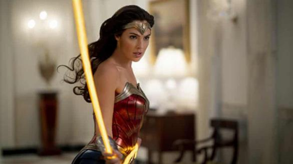 Wonder Woman stands with her lasso of truth