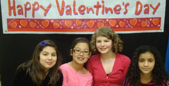 Friends take a break from dancing for a Valentine's Day group photo.
