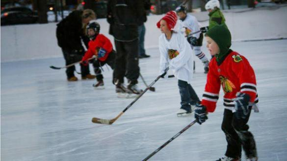 Young kids participate in the Chicago Blackhawks Hockey Clinic at McKinley Park.