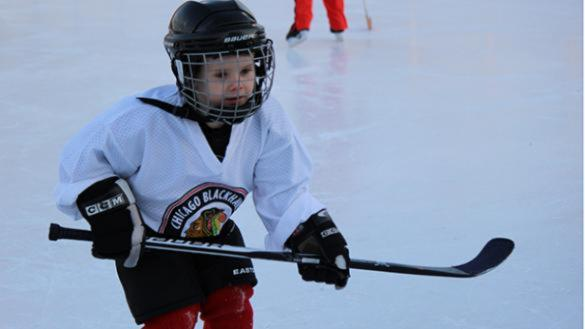 A young boy participates in a Chicago Blackhawks Hockey Clinic in the parks.