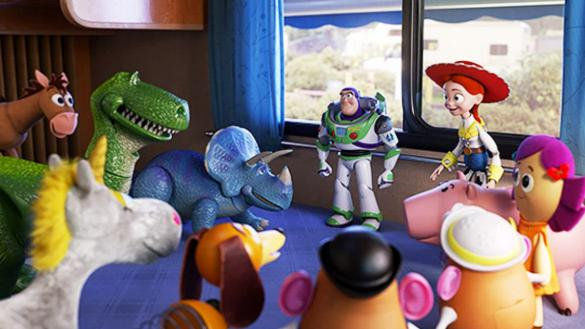 Buzz Lightyear, a space ranger action figure, stands talking an assembled group of children's toys.