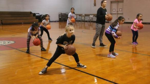 Girls doing basketball skills