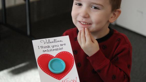 little boy making valentine's day card!