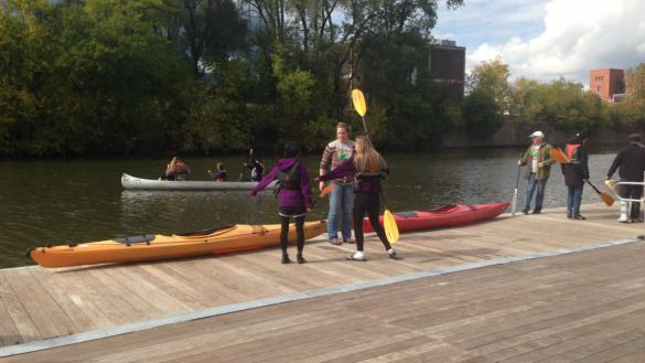 Boats are in the water at Clark Park Boathouse