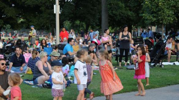 Tuesdays in the Parks concerts are a hit with the kiddos at Welles Park.