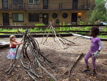 Twp girls get creative while playing in a Nature Play Space.