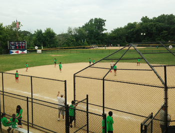 A friendly game of baseball takes place on a Park District baseball field.