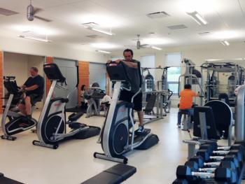 People working out in the Ping Tom Park fitness center
