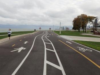 Woman runs along a newly separated segment of the Lakefront Trail
