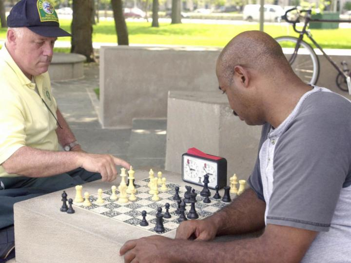 Men playing chess at North Ave