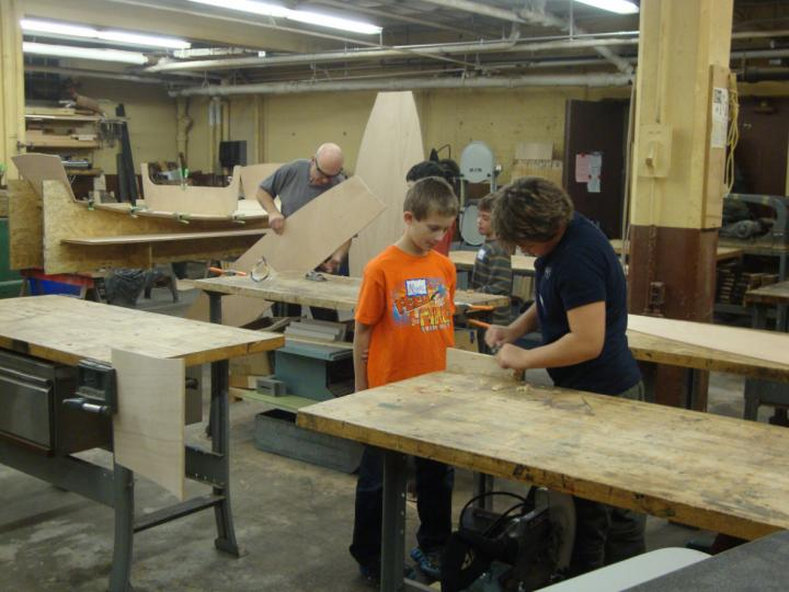 Instructor working with a youth at the Lincoln Park wood shop.