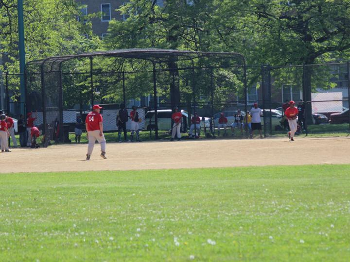 Youth boys playing baseball at Loyola Park