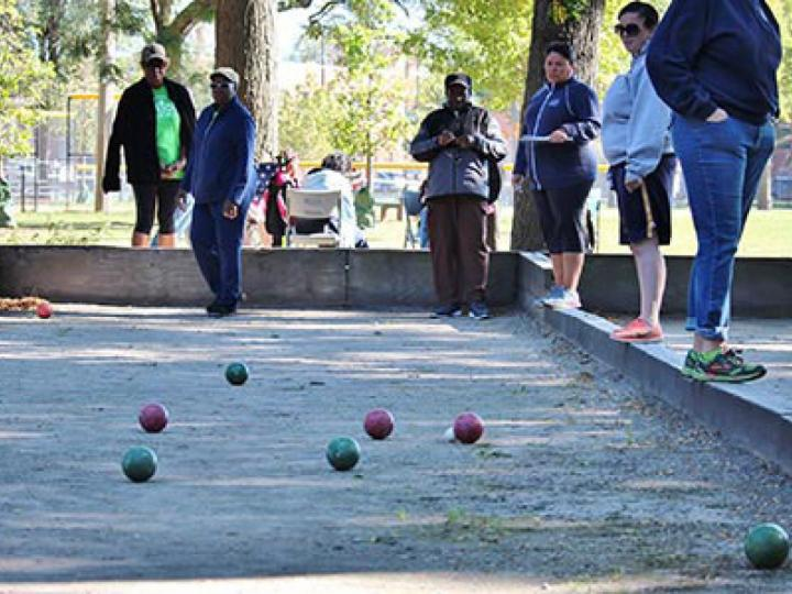 Adults playing bocce at McGuane Park