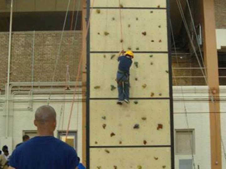 Kid on the climbing wall at Broadway Armory